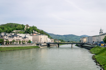 mozart: Salzburg, Austria - April 29, 2015:   Salzach river. Salzburg is renowned for its baroque architecture and was the birthplace of Mozart. It is an Unesco World Heritage Site. Editorial