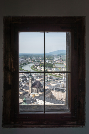 mozart: Salzburg, Austria - April 29, 2015:   Framed view of the city from Hohensalzburg Castle. Salzburg is renowned for its baroque architecture and was the birthplace of Mozart. It is an Unesco World Heritage Site. Editorial