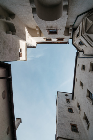 amadeus: Salzburg, Austria - April 29, 2015:   Low angle view of buildings of Hohensalzburg Castle. Salzburg is renowned for its baroque architecture and was the birthplace of Mozart. It is an Unesco World Heritage Site. Editorial