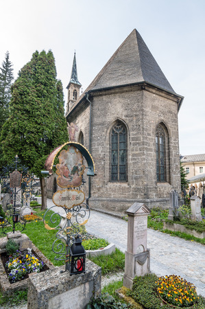 Salzburg, Austria - April 29, 2015:   St. Peter Cemetery. Salzburg is renowned for its baroque architecture and was the birthplace of Mozart. It is an Unesco World Heritage Site. Editorial
