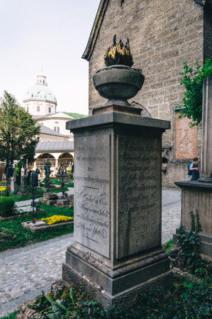 baroque architecture: Salzburg, Austria - April 29, 2015:   St. Peter Cemetery detail. Salzburg is renowned for its baroque architecture and was the birthplace of Mozart. It is an Unesco World Heritage Site.