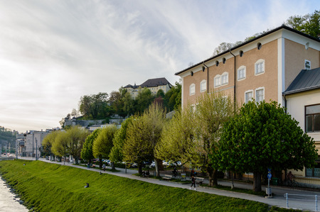 baroque architecture: Salzburg, Austria - April 29, 2015:   Riverside of Salzach river. Salzburg is renowned for its baroque architecture and was the birthplace of Mozart. It is an Unesco World Heritage Site. Editorial
