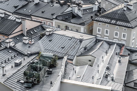salzach: Salzburg, Austria - April 29, 2015: Cityscape from the hill of Kapuzinerberg at dusk. Zinc roofs in residential buildings. Salzburg was the birthplace of Mozart. It is an Unesco World Heritage Site.