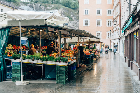renowned: Salzburg, Austria - April 30, 2015: Street food market. Salzburg is renowned for its baroque architecture and was the birthplace of Mozart. It is an Unesco World Heritage Site.
