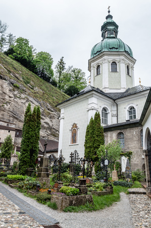 Salzburg, Austria - April 30, 2015:   St. Peter Cemetery. Salzburg is renowned for its baroque architecture and was the birthplace of Mozart. It is an Unesco World Heritage Site. Editorial