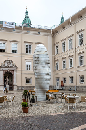 renowned: Salzburg, Austria - April 29, 2015:  Human head statue in a square in Salzburg. Salzburg is renowned for its baroque architecture and was the birthplace of Mozart. It is an Unesco World Heritage Site.