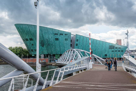 nemo: Amsterdam, Netherlands - August 1, 2016: Contemporary architecture in  Amsterdam. Nemo Science Museum a cloudy day