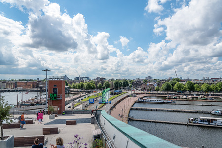 nemo: Amsterdam, Netherlands - August 1, 2016: Cityscape of Amsterdan a blue sky day with pretty white clouds from Nemo Science Museum Editorial