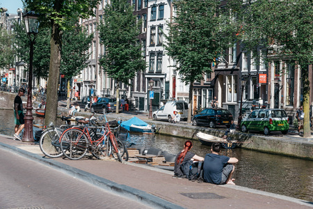 canal house: Amsterdam, Netherlands - August 1, 2016: Canal house in Amsterdam a blue sky day