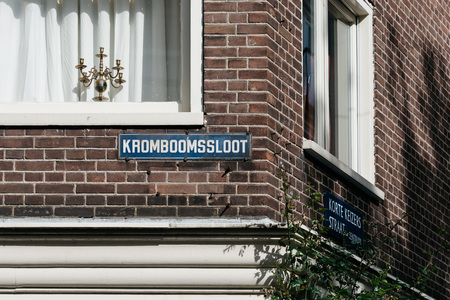 canal houses: Amsterdam, Netherlands - August 1, 2016: Amsterdam cityscape, canal houses in Red Light District Editorial