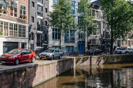 Amsterdam, Netherlands - August 1, 2016: Amsterdam cityscape, canal houses in Red Light District Editorial