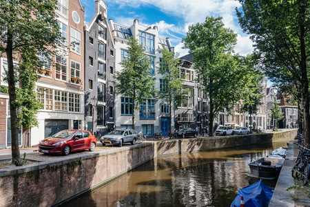 dutch canal house: Amsterdam, Netherlands - August 1, 2016: Amsterdam cityscape, canal houses in Red Light District Editorial