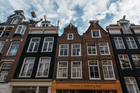 canal houses: Amsterdam, Netherlands - August 1, 2016: Canal houses in Amsterdam a blue sky day Editorial