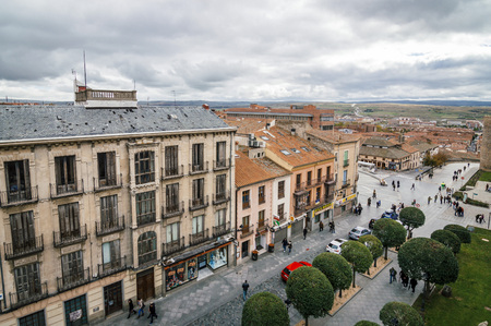 Avila, Spain - November 11, 2014:  View of Avila from Medieval Walls a cloudy day. The old city and its extramural churches Editorial