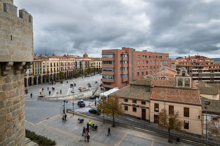 Avila, Spain - November 11, 2014:  Scenic view of Avila cityscape from the Medieval Walls. The old city and its extramural churches