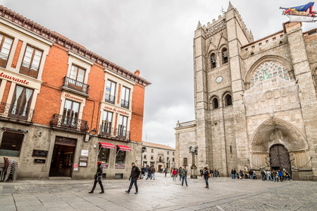 Avila, Spain - November 11, 2014:  People in the square in front of the Cathedral of Avila. The old city and its extramural churches
