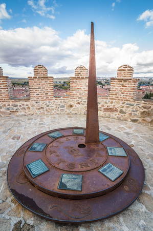 Avila, Spain - November 11, 2014:  Metal Sundial in The Medieval Walls of Avila. The old city  and its extramural churches Editorial
