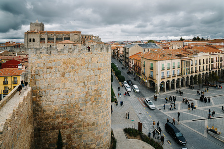 Avila, Spain - November 11, 2014:  Cityscape of Avila from Medieval Walls a cloudy day. The old city and its extramural churches