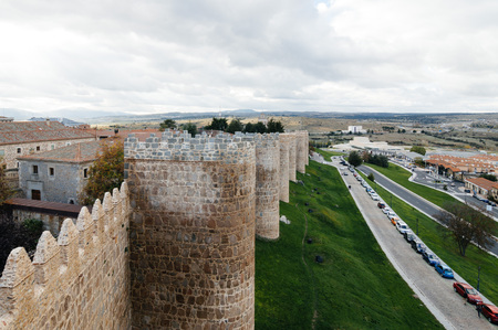 Avila, Spain - November 11, 2014:  The Medieval Walls of Avila. The old city  and its extramural churches were declared a World Heritage site by UNESCO Editorial