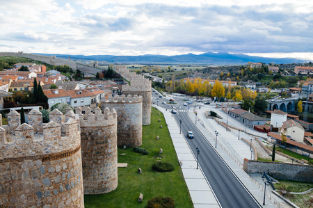 Avila, Spain - November 11, 2014:  Cityscape of Avila from Medieval Walls a cloudy day at sunset. The old city  and its extramural churches were declared a World Heritage site by UNESCO