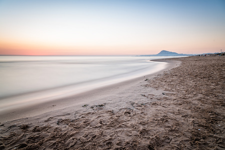 oliva: Scenic View Of Sea Against Sky At Morning in Oliva, Valencia, Spain. Long exposure shot, blurred motion