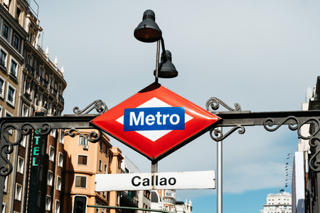 Madrid, Spain - September 18, 2016:  Madrid Metro sign at the entrance to Callao station at Gran Via Street in Madrid. Low angle view, horizontal composition