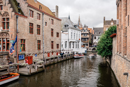 Bruges, Belgium - July 29, 2016: Canal scene in the city of Bruges. The historic city centre is a World Heritage Site of UNESCO. It is known for his picturesque cobbled lanes and dreamy canals Editorial