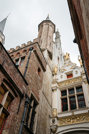 Bruges, Belgium - July 29, 2016: Low angle view of Town Hall Tower of Bruges. The historic city centre is a World Heritage Site of UNESCO. It is known for his picturesque cobbled lanes and dreamy canals