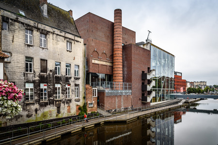 feats: Mechelen, Belgium - July 30, 2016: Lamot conference centre situated at the waterside, in the historic centre of Mechelen. The former brewery is one of the most daring feats of contemporary architecture.