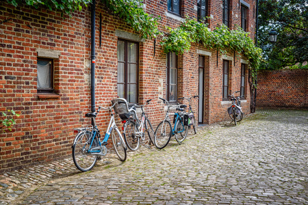 Leuven, Belgium - July 30, 2016:  The Grand Beguinage of Leuven, is a well preserved and completely restored historical quarter is owned by the University of Leuven and used as a campus. Bicycles parked Editorial
