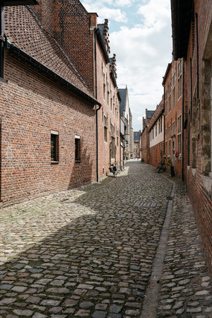 completely: Leuven, Belgium - July 30, 2016:  The Grand Beguinage of Leuven, is a well preserved and completely restored historical quarter is owned by the University of Leuven and used as a campus. Editorial