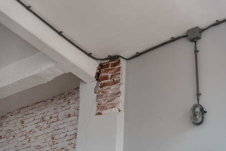 Old brick wall background with chipped paint, horizontal