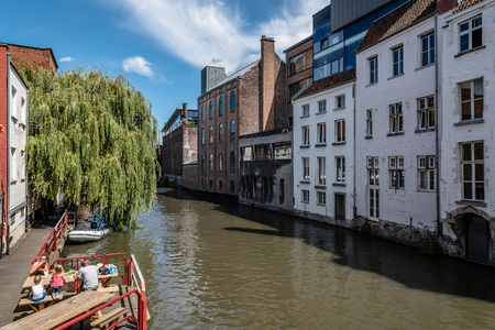 Ghent, Belgium - July 31, 2016: Canal in the historic center of Ghent with picturesque old buildings