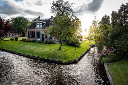 Giethoorn, Netherlands - August 5, 2016: The village Giethoorn is unique in the Netherlands because of its bridges, waterways and typical boats calle punters.  It is also called the Venice of Holland
