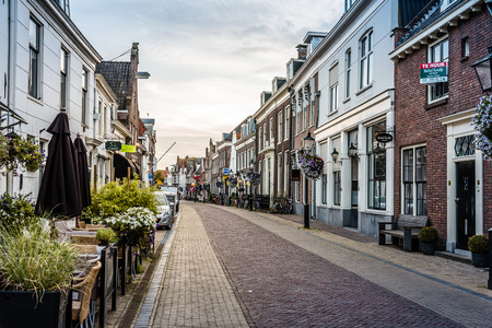 vanishing point: Naarden, Netherlands - August 5, 2016: Picturesque street in Naarden city centre. Naarden was developed into a fortified garrison town with a textile industry. It is an example of a star fort, complete with fortified walls and a moat.