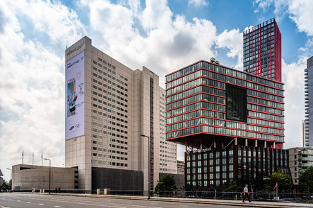 arisen: Rottedam, The Netherlands - August 6, 2016: Modern architecture office building in Rotterdam. Many new towers have arisen, and many new iconic buildings designed.