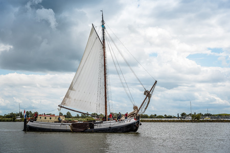 Enkhuizen, Netherlands - August 5, 2016: Old sailing ship in the harbour. At the peak of its power Enkhuizen was one of the most important harbour cities in the Netherlands Editorial