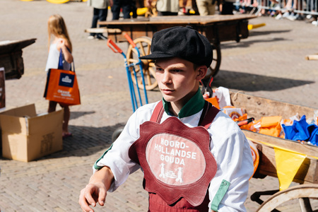 famous industries: Alkmaar, Netherlands - August 5, 2016: Cheese market.  Alkmaar is well known for its traditional cheese market. For tourists, it is a popular cultural destination Editorial