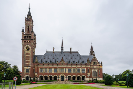 the hague: The Hague, The Netherlands - August 7, 2016:  The Peace Palace a cloudy day of summer. It is an international law administrative building in The Hague, the Netherlands Editorial