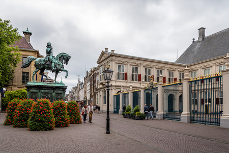 The Hague, The Netherlands - August 7, 2016: Entrance to Noordeinde Palace. It  is one of the three official palaces of the Dutch royal family. and has been used as the working palace for King.