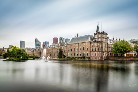 Hague, Netherlands - August 7, 2016:  Hofvijver, Court Pond, artificial lake beside the Binnenhof. Binnenhof  is a complex of buildings in the city centre of The Hague. Office of the Prime Minister and House of Representatives.