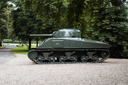 Oosterbeek, Netherlands - August 09, 2016: Sherman battle tank in the garden of Airborne Museum Hartenstein. It is dedicated to the Battle of Arnhem in which the Allied Forces attempted to form a bridgehead on the northern banks of the Rhine river Editorial