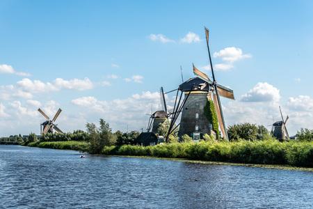 dutch: Beautiful dutch windmill landscape at Kinderdijk in the Netherlands a blue sky day of summer