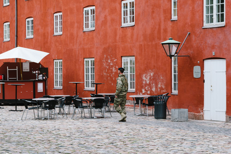 Copenhagen, Denmark - August 10, 2016. A soldier in the Kastellet a cloudy day of summer. It is one of the best preserved star fortresses in Northern Europe. It is constructed in the form of a pentagram with bastions at its corners. Editorial