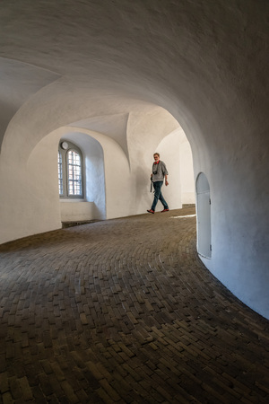 corridors: Copenhagen, Denmark - August 11, 2016. The Rundetaarn  is a  tower located in central Copenhagen,  it was built as an astronomical observatory. It is most noted for its equestrian staircase, a helical corridor, and for the expansive views.