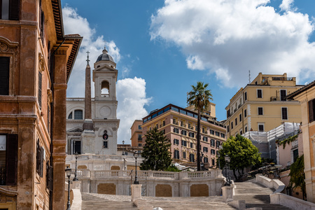 low perspective: Rome, Italy - August 18, 2016: Piazza di Spagna and spanish steps to Piazza della Trinita dei Monti with no people a sunny summer day. It is a main square in the historical centre of Rome.