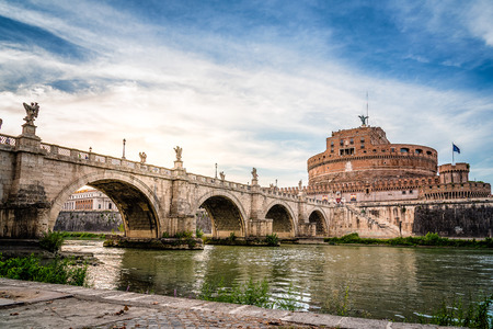 Rome, Italy - August 18, 2016:  Bridge and Mausoleum Castel Sant Angelo at sunset. The Mausoleum of Hadrian, usually known as Castel SantAngelo is a towering cylindrical building in Rome Editorial