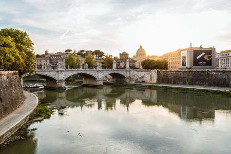 tiber: Rome, Italy - August 18, 2016:  Scenic  view of Vatican city at sunset from Bridge of Castel Sant Angelo.