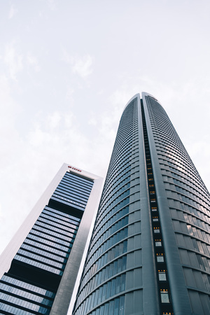 Madrid, Spain - June 25, 2017: Low angle view of  skyscraper in Cuatro Torres Business Area, CTBA, Four Towers Business Area, a business district in Madrid against sky