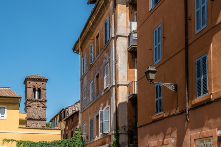 Rome, Italy - August 20, 2016: Low angle view of historic buildings in Trastevere a picturesque neighbourhood in historical centre of Rome a sunny summer day.